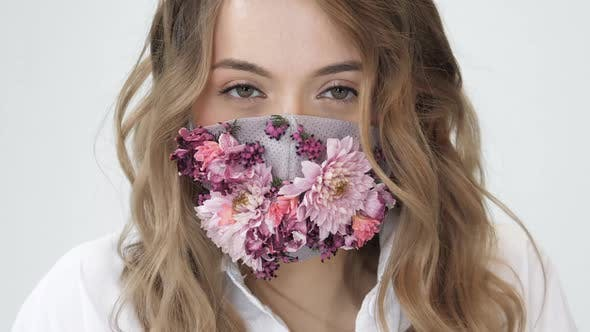 Beautiful Girl Wear Safe Mask of Fresh Flower, Breath Clean Air Pollution  Prevention, Free Life Care by CoolFotage