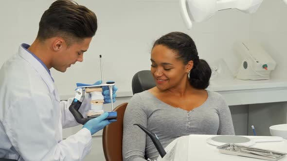 Dentist Talking To His Patient Showing Her Dental Mold 1080p by kotlyarn