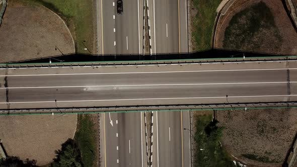 Top Down Zoom Out View of Highway Intersection Car Bridge and Moving