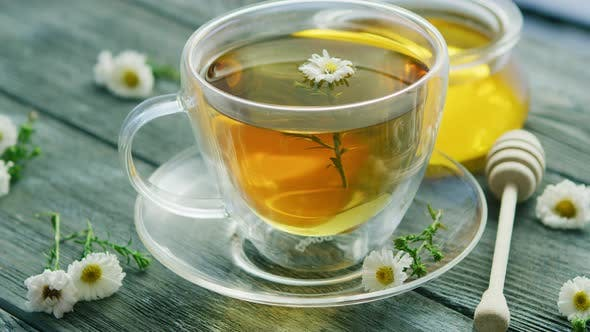 Closeup of Cup with Camomile Tea