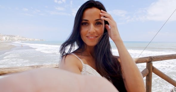 63ad094a5a Pretty Young Woman At The Beach Taking Selfie by Daniel_Dash | VideoHive