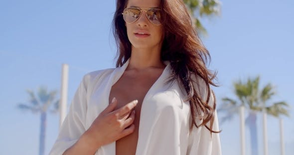 Woman Seductively Touching Cleavage On Beach By Daniel Dash