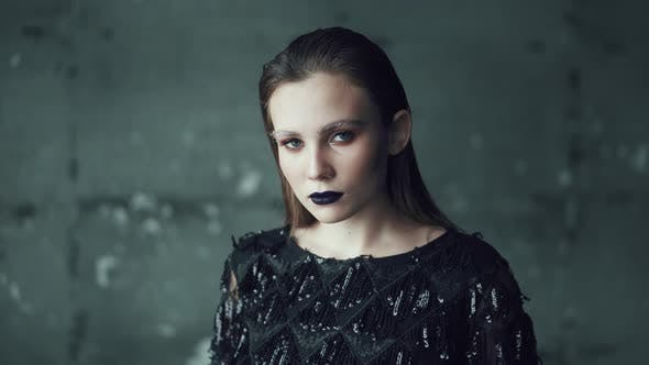 Portrait of a Girl with Bright Makeup and Blue Lips on a Dark Background. Young Woman with Unusual (Stock Footage)
