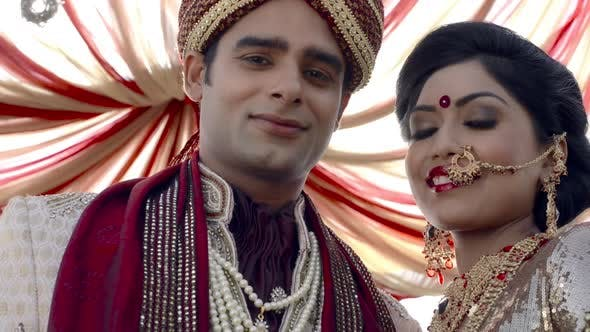 81c6595553 Shot Of Indian Bride And Groom In Traditional Wedding Dress Under A Mandap  4 (Stock Footage)