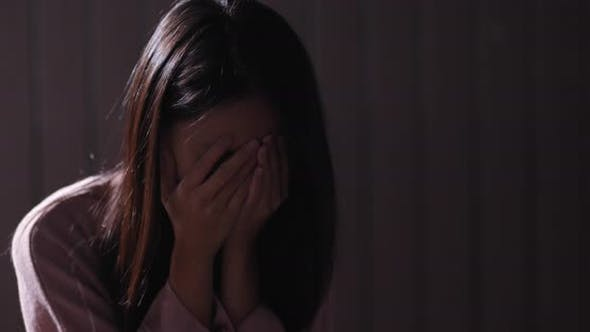 Woman crying in the dark