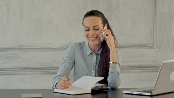 Happy Businesswoman Talking On The Cell Phone By Fancystudio