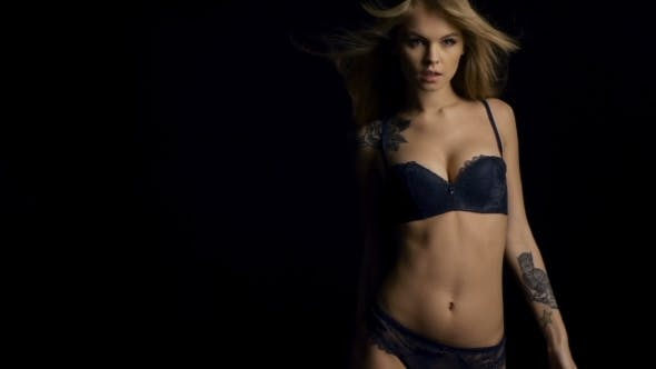 0d5a2e32531 Sexy Woman In Lingerie With Tatto On Dark Background (Stock Footage)