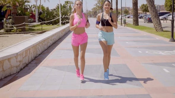 Two Attractive Athletic Young Women Jogging By Daniel Dash Videohive Select from premium women jogging of the highest quality. two attractive athletic young women jogging