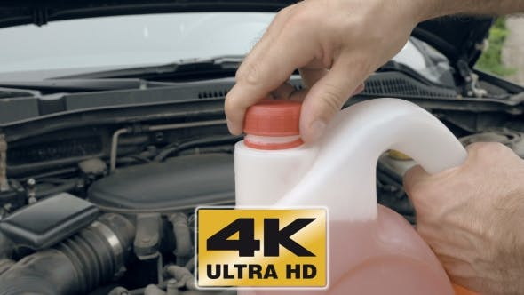 Opening Bottle With Pink Windshield Washer Fluid Stock Footage