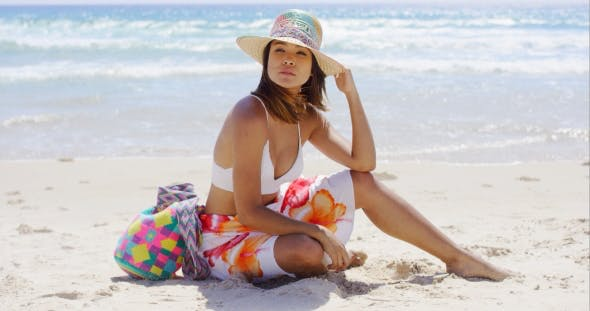 a4e33f1ef6 Pretty Young Woman Sitting On The Beach Sand by Daniel_Dash | VideoHive