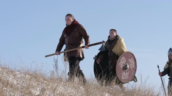 Group of Vikings with Shields and Swords Going Forward on
