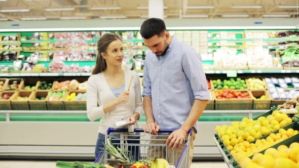 Couple With Food In Shopping Cart At Grocery Store 13 By