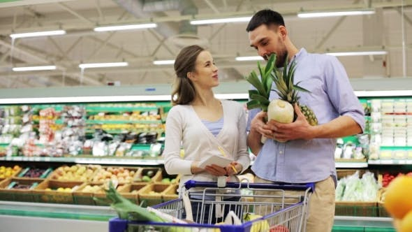 Couple With Food In Shopping Cart At Grocery Store 15 By