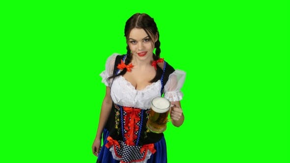77344404cdd9 Girl in Bavarian Costume Celebrates Oktoberfest Beer Drinkers and Beckons.  Green Screen (Stock Footage)