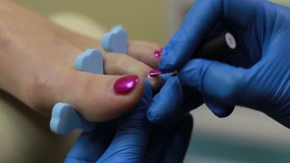 Pedicurist Applying Nail Polish To Toenails By Stusya Videohive