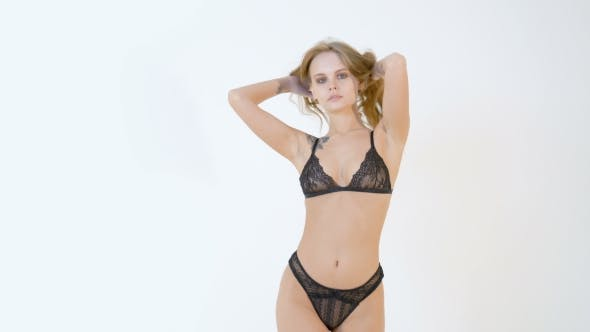 7e6094a0b0d Beautiful Woman in Sexy Black Lingerie Posing on a White Background (Stock  Footage)