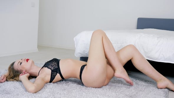 Lace Underwear On Sexy Female Body That Lies On Floor At