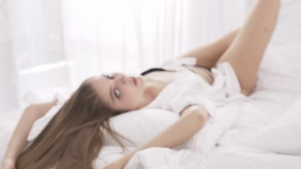 424dd8400729 Sensual Sexy Caucasian Blonde Woman in Black Lace Lingerie Looking at the  Camera While Laying Down (Stock Footage)