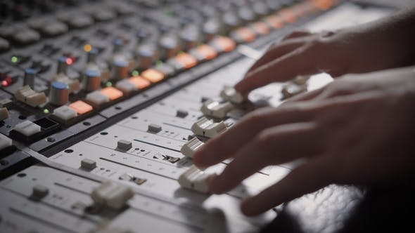 Shot of Professional Dj's Hands Working with a Recording