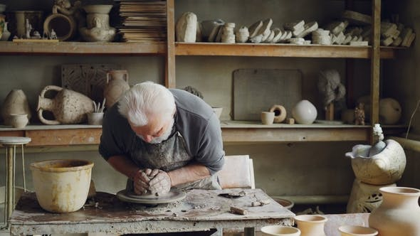 Creative Craftsman Is Working With Clay On Potter S Wheel Creating