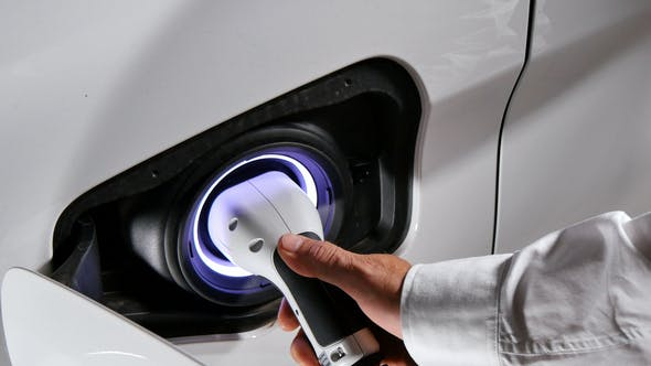 Connecting The Charger Plug Of An Electric Hybrid Car Stock Footage