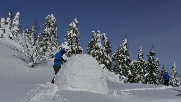 Snow Igloo Building in the High Mountain by ivankmit | VideoHive
