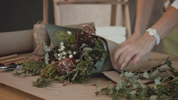 Florist Wrapping Flower Bouquet In Kraft Paper By Alona2018 Videohive