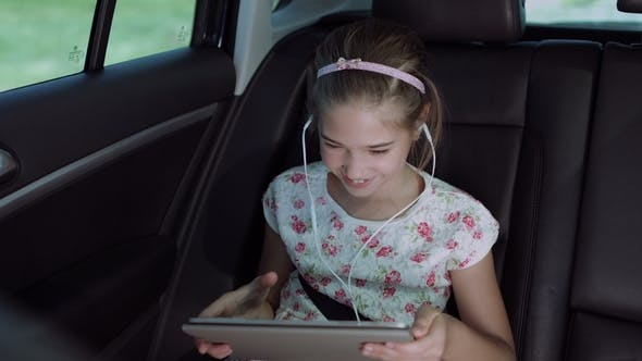 Child Playing Online Game With Tablet Pc In Car By Alona2018 Videohive