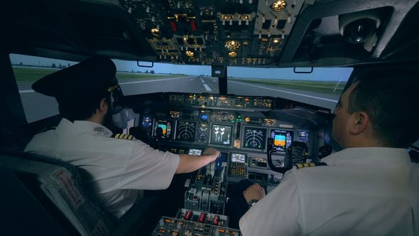 Professional Pilot Is Giving Instructions To an Amateur