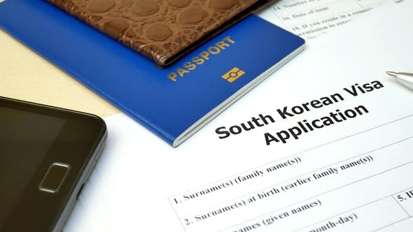 South Korean Visa Application Form with Passport and Pen by