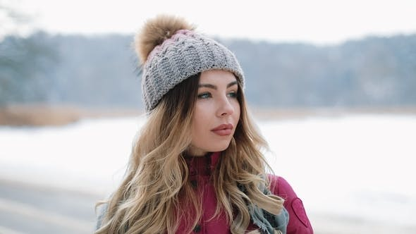 5555b683ad7 Pretty Woman in Winter Hat Smiles Standing Outside on the Snow (Stock  Footage)
