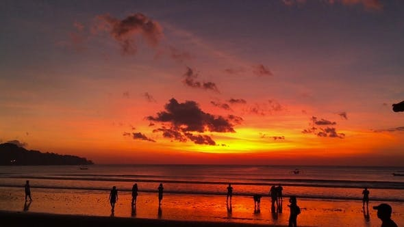 Beautiful Sunset On The Beach Of The Jimbaran Village With
