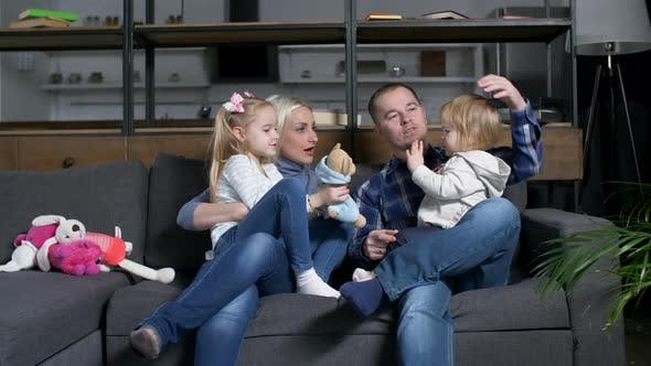 Happy Family Communicating with Toddler Girl at Home (Stock Footage)