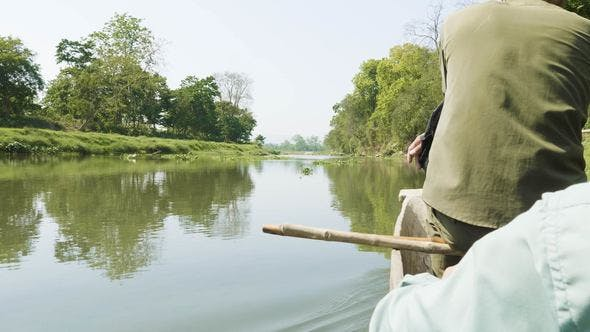 Canoeing in the River of Rainforest in the National Park Chitwan