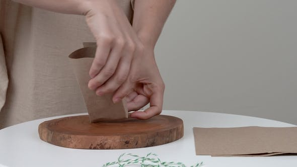 A of Woman's Hands Wrapping a Bar of Soap  She Is Winding a Rope