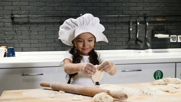 Little Pretty Girl In Chef Hat And Apron Kid Chef Concept Adorable