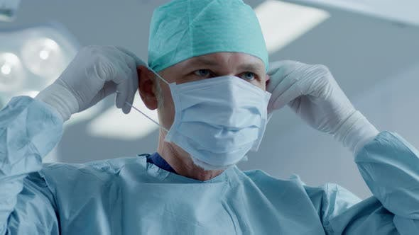 Surgical The Of In Portrait Surgeon Mask Modern Background On Putting Professional Hospital