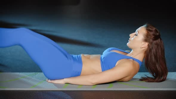 Female Athlete Sit Ups Exercises Lifting Legs Torso Abs Crunches