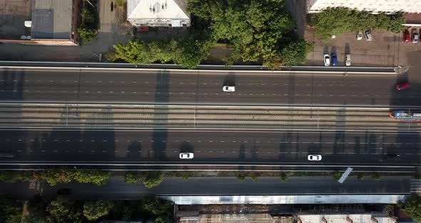 Aerial Top Down View of Traffic Jam on a Car Bridge and Moving Tram