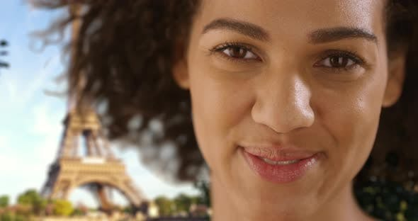 Slowmo Of Gorgeous African Woman Smiling And Laughing Near Eiffel