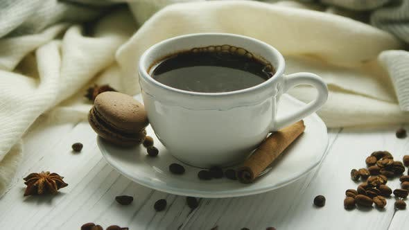 Cup of Coffee with Spices and Macaron