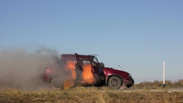 Car Explosion On The Road Burning Side View Stock Footage