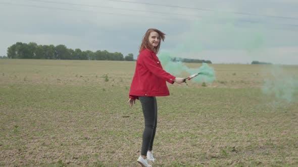 Woman with Colored Smoke Bomb Enjoying Nature by Alona2018