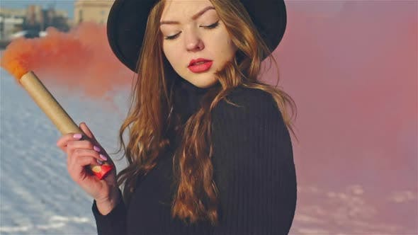 691abce62ea Young Woman with Two Red Signal Smoke Bombs Slow Motion by ...