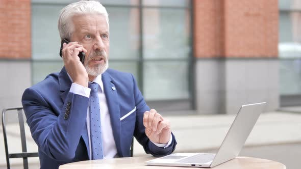 Angry Old Businessman Talking On Phone By Stockwood Videohive