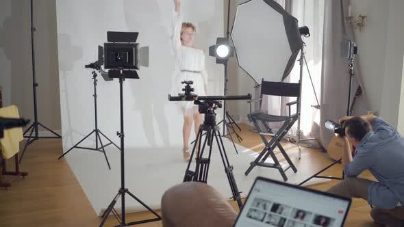 Professional Photographer Taking Photos of Young Female