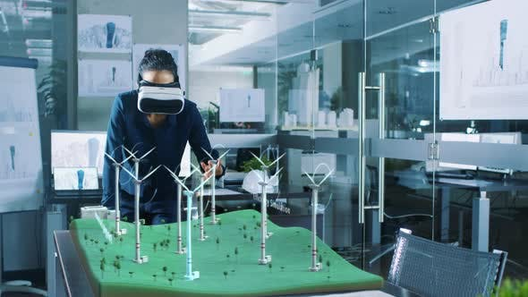 c7fff6429159 Futuristic Female Engineer using Virtual Reality Environment for Designing  and Testing Wind Turbines (Stock Footage)