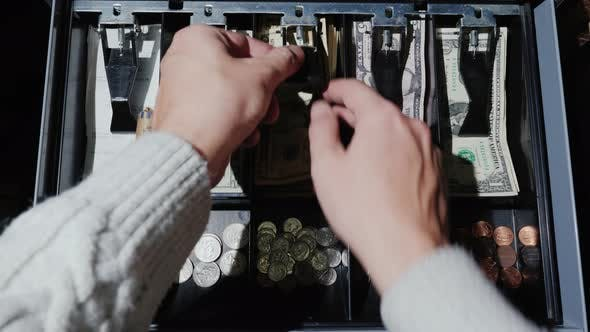 POV Video: The Cashier Puts the Money in the Cash Register