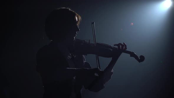 Dark Studio with Lanterns Girl Playing the Violin by
