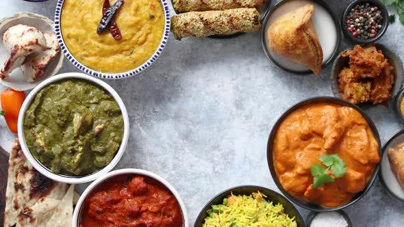 Assorted Indian Food On Stone Background Dishes Of Indian